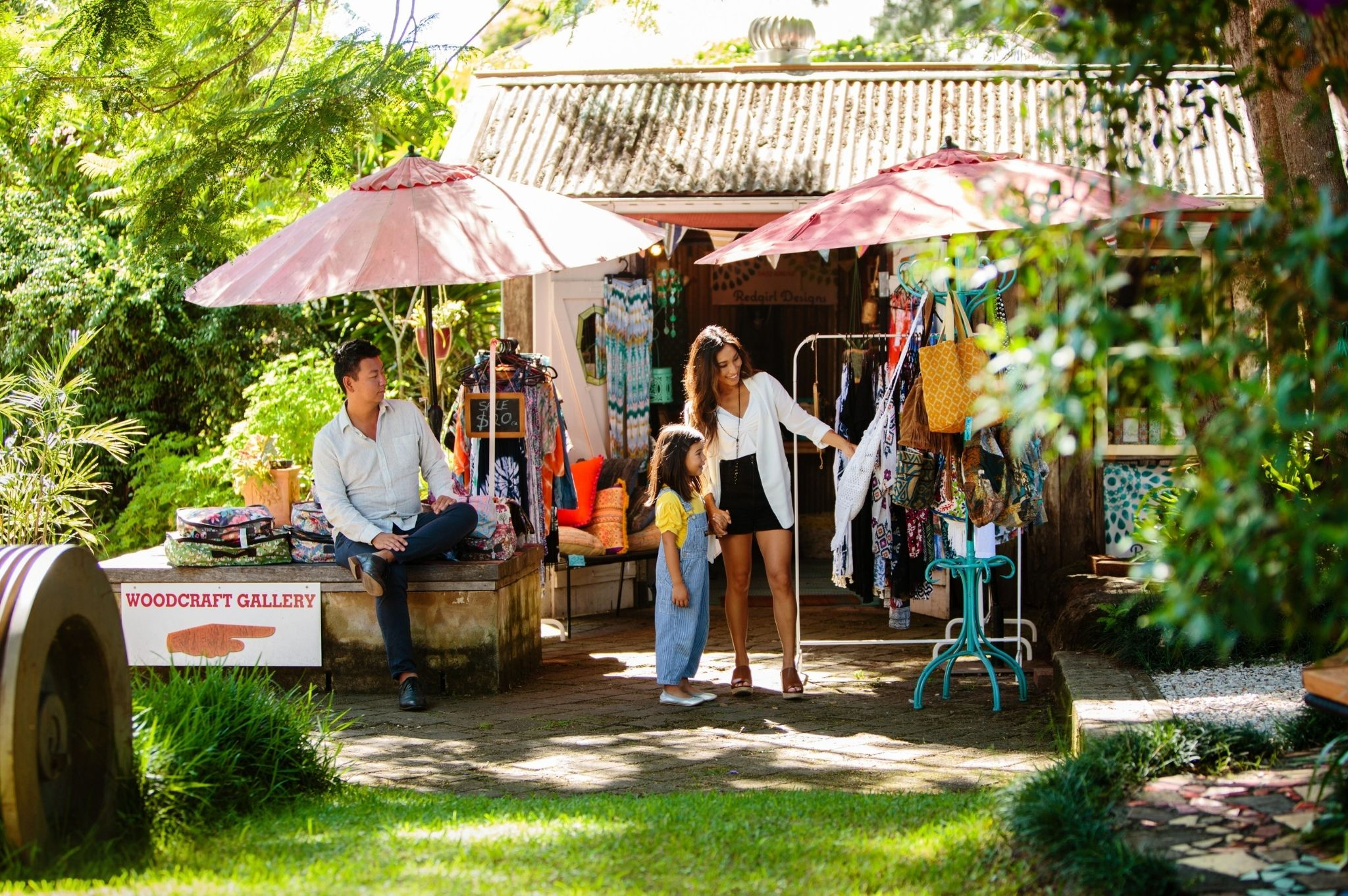 Image of a family shopping at local markets in Bellingen NSW