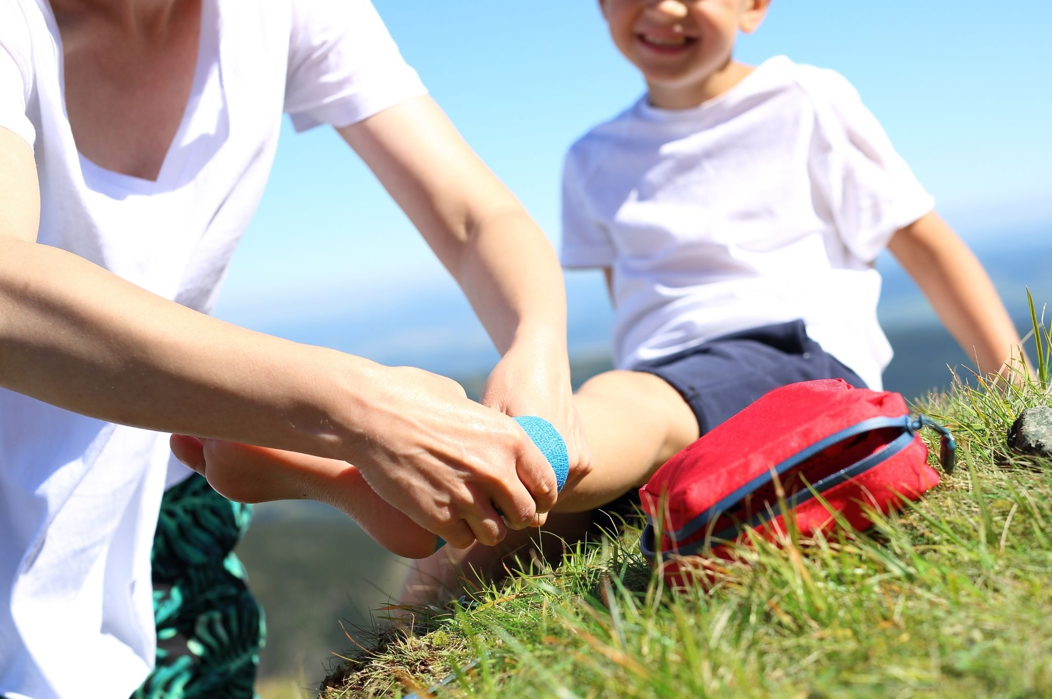 Image of a woman bandaging a child's foot