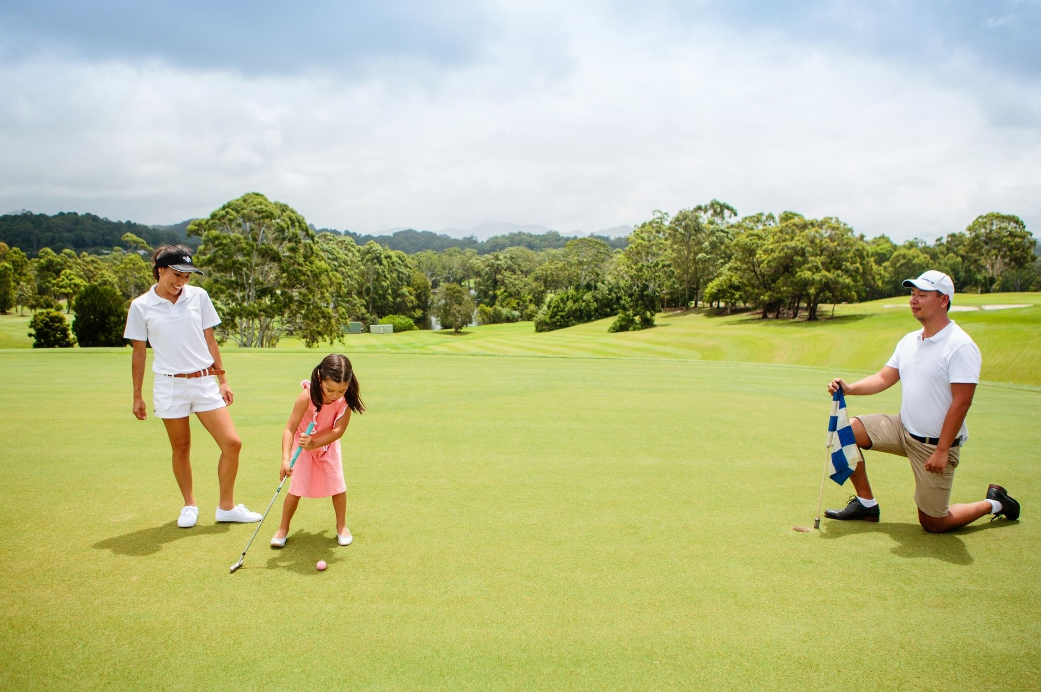 Image of a family on a NSW golf course