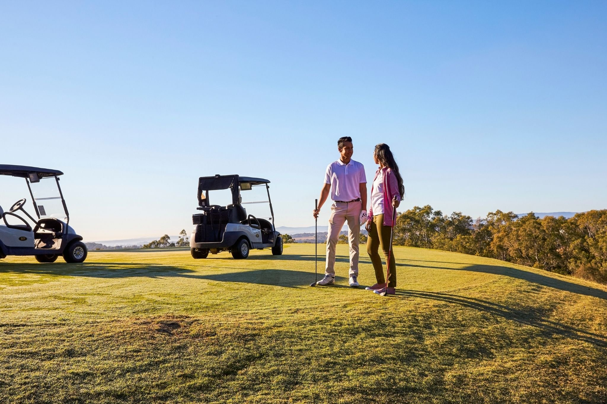 Image of a couple on the green of a NSW golf course