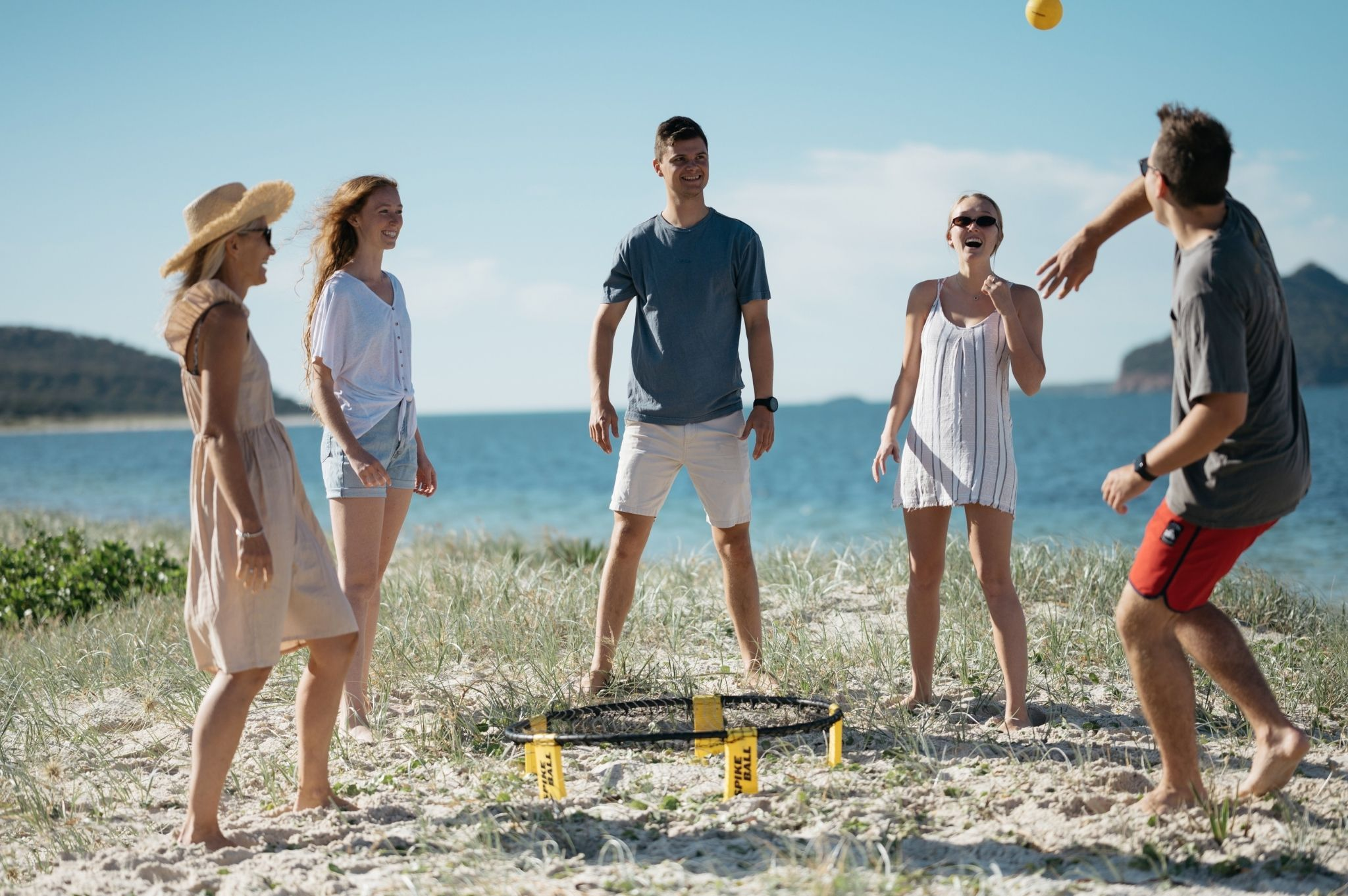 Images of a family playing ball games at Reflections Holiday Parks Jimmys Beach
