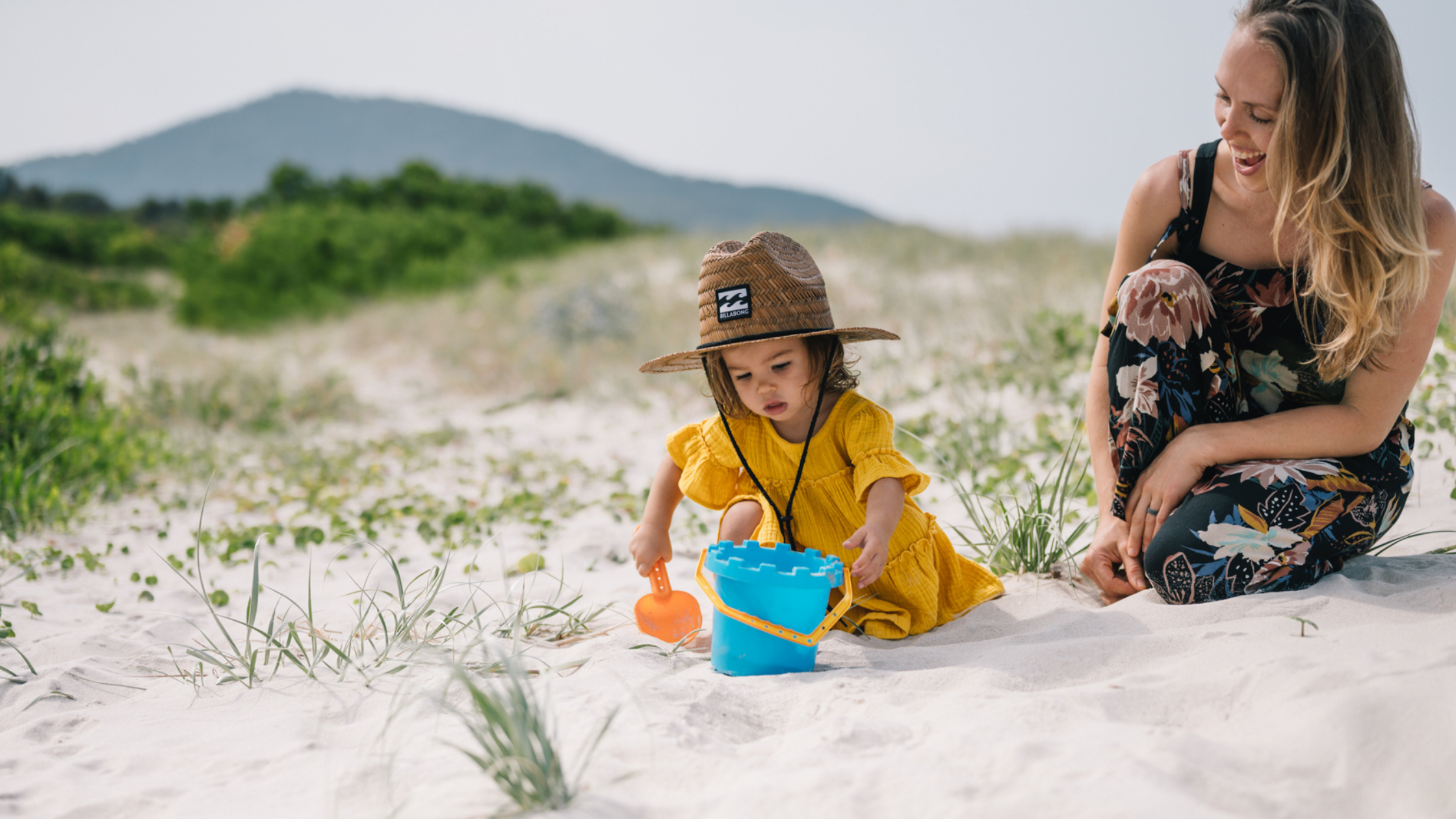 Image of a woman and child making sandcastles at Reflections Holiday Parks Jimmys Beach
