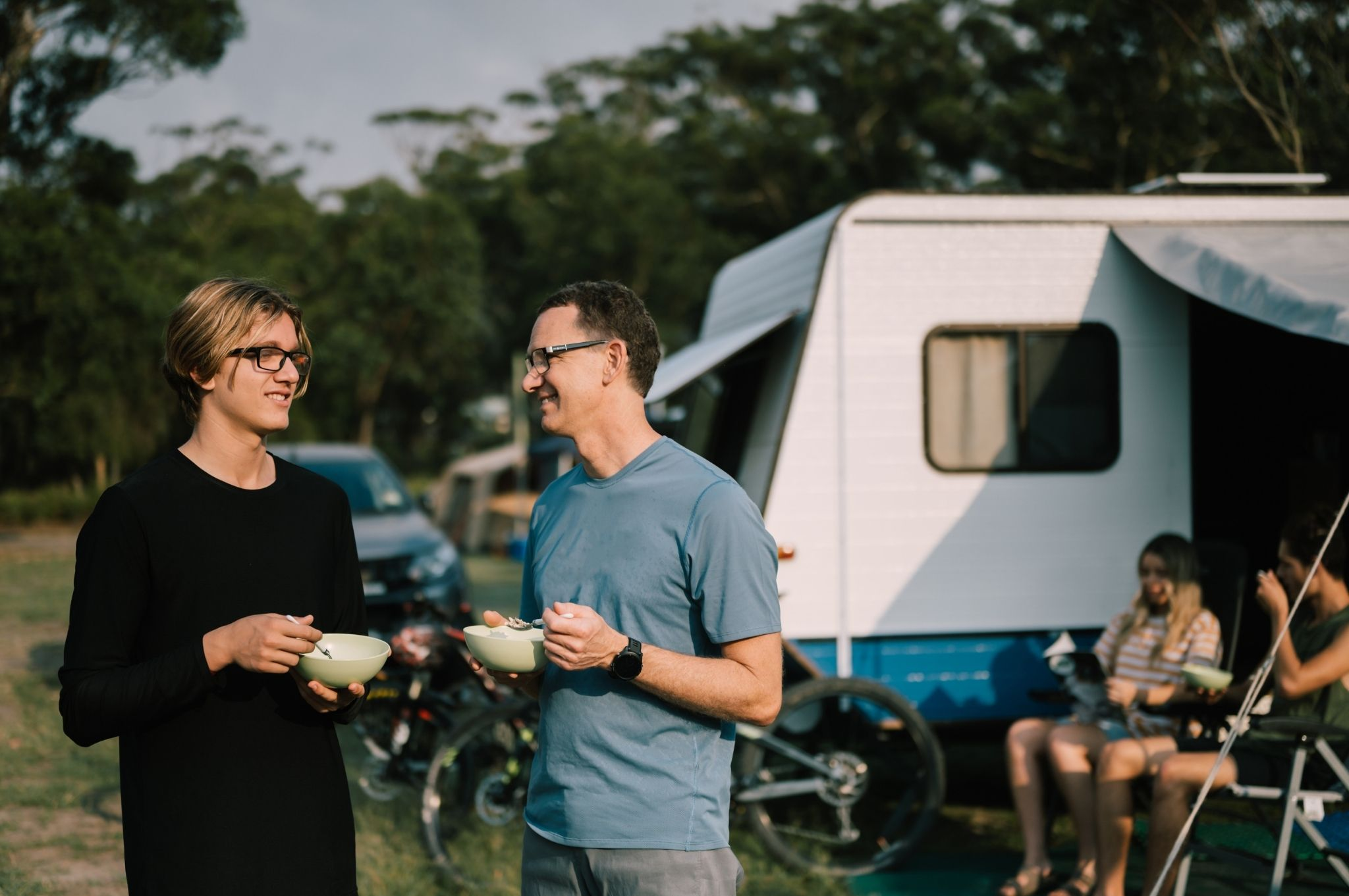 Image of two men eating breakfast at Reflections Holiday Parks Jimmys Beach
