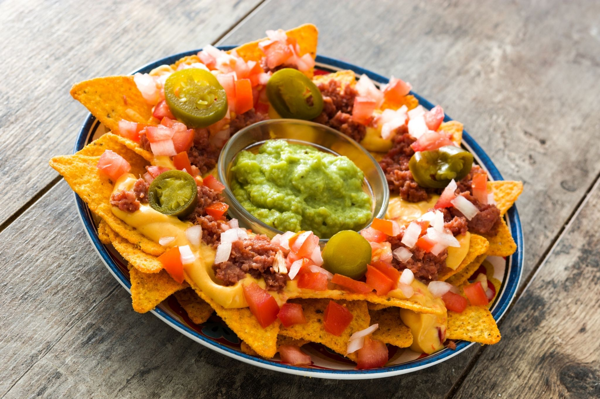 Image of a plate of nachos and guacamole