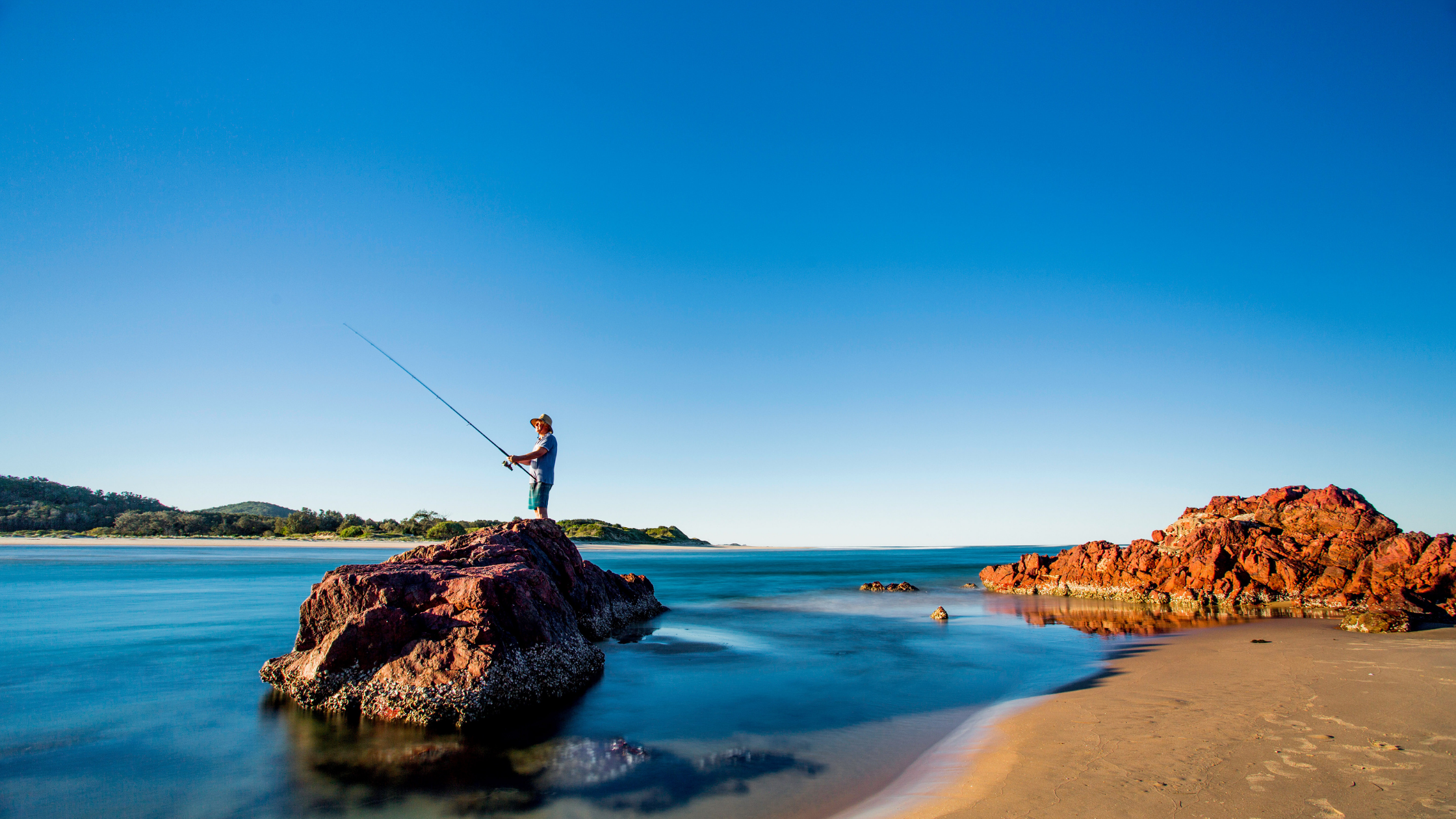 Image of a man fishing at Red Rock Beach in NSW