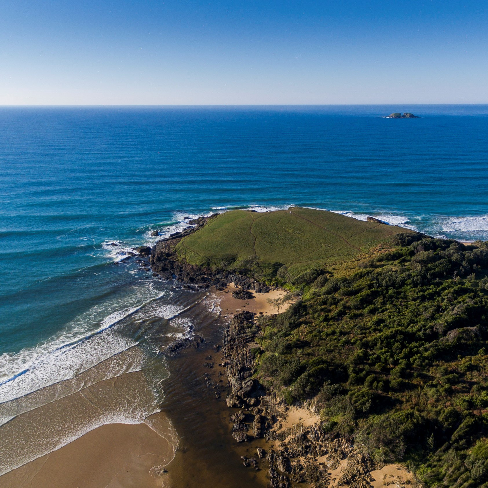 An aerial view of Look at Me Now Headland in the Coffs Coast Region of NSW
