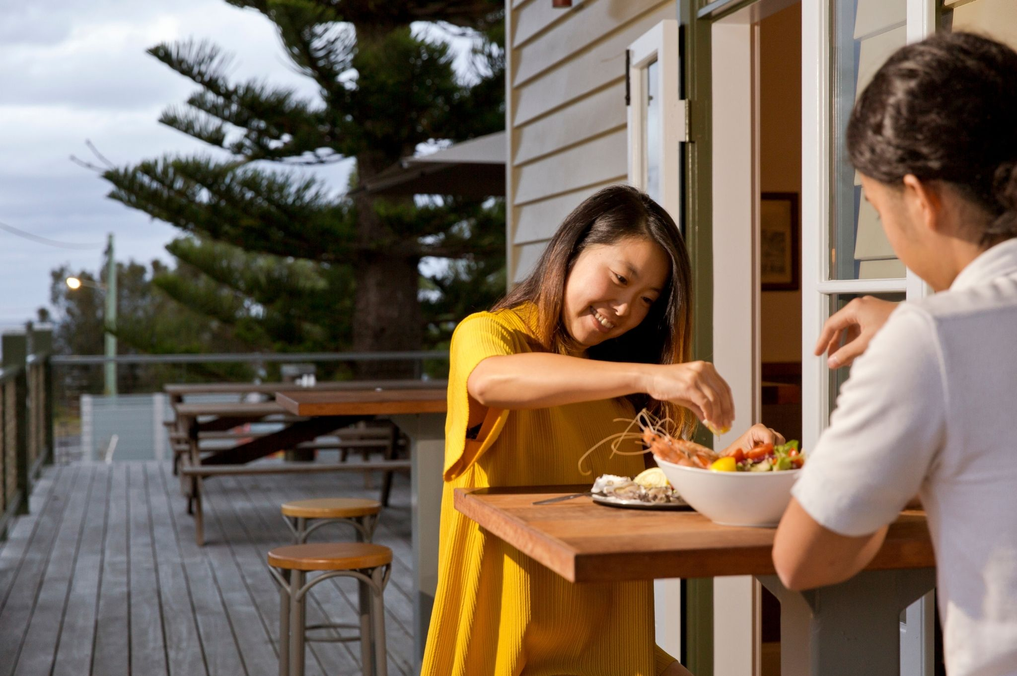 Image of a couple eating fresh seafood at Tathra Hotel in Tathra NSW