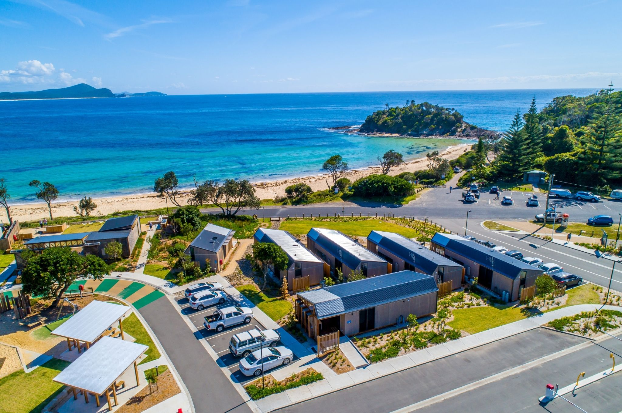 An aerial view of cabin accommodation at Reflections Holiday Parks Seal Rocks