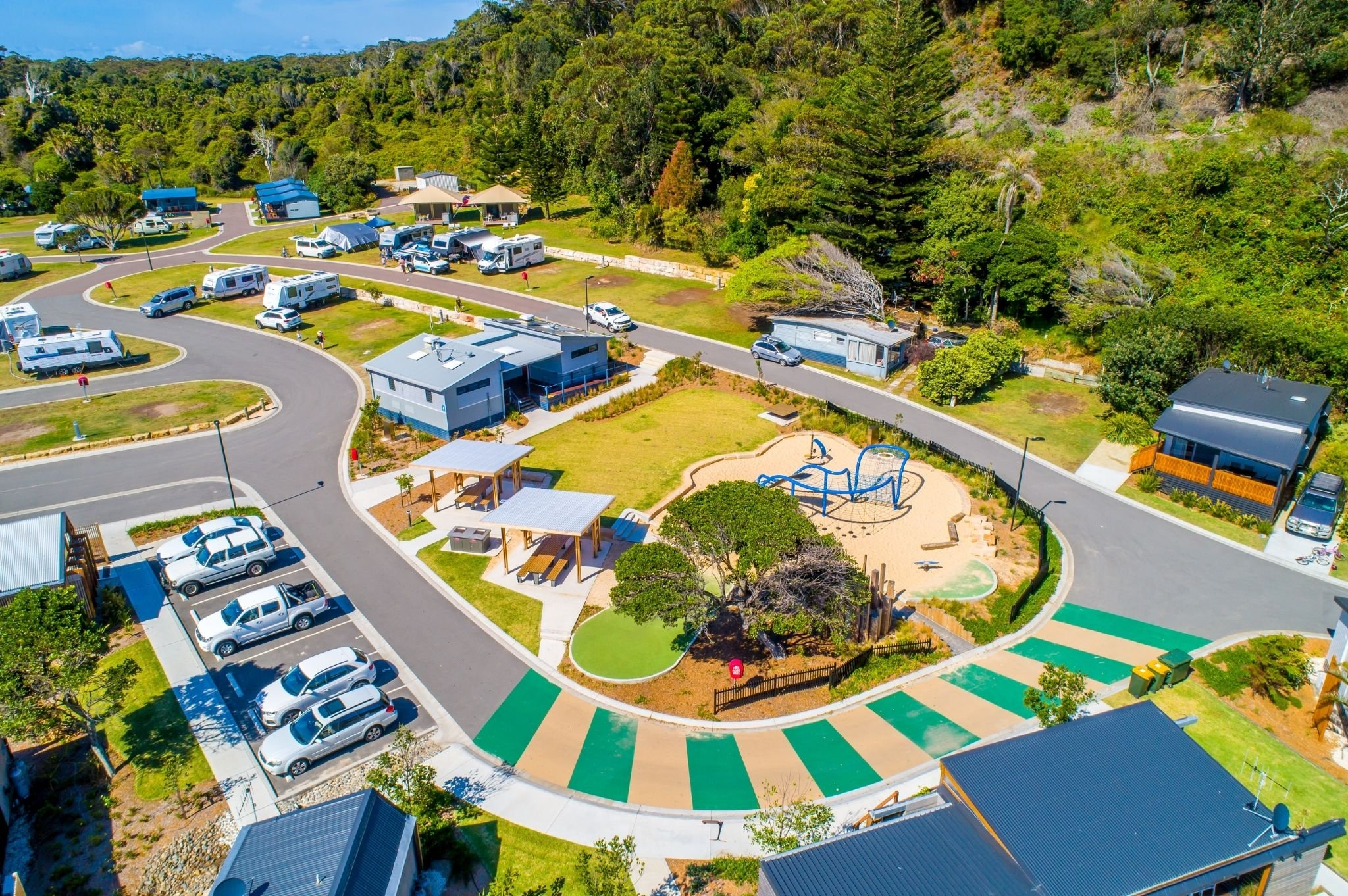 An aerial image of the children's playground at Reflections Holiday Parks Seal Rocks