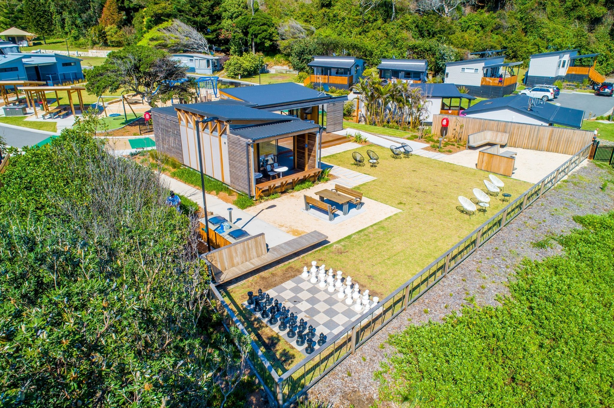 An aerial view of the camp kitchen and cabins at Reflections Holiday Parks Seal Rocks