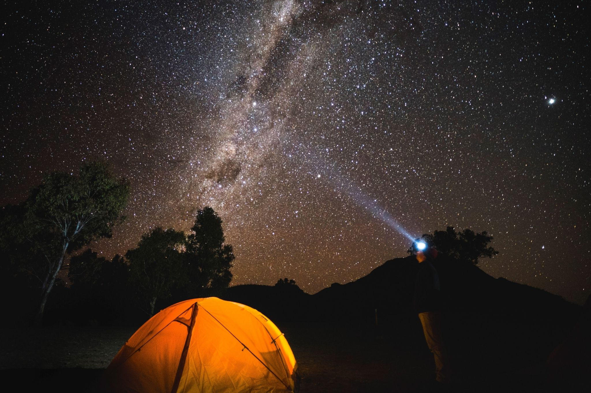 Image of person stargazing at their campsite