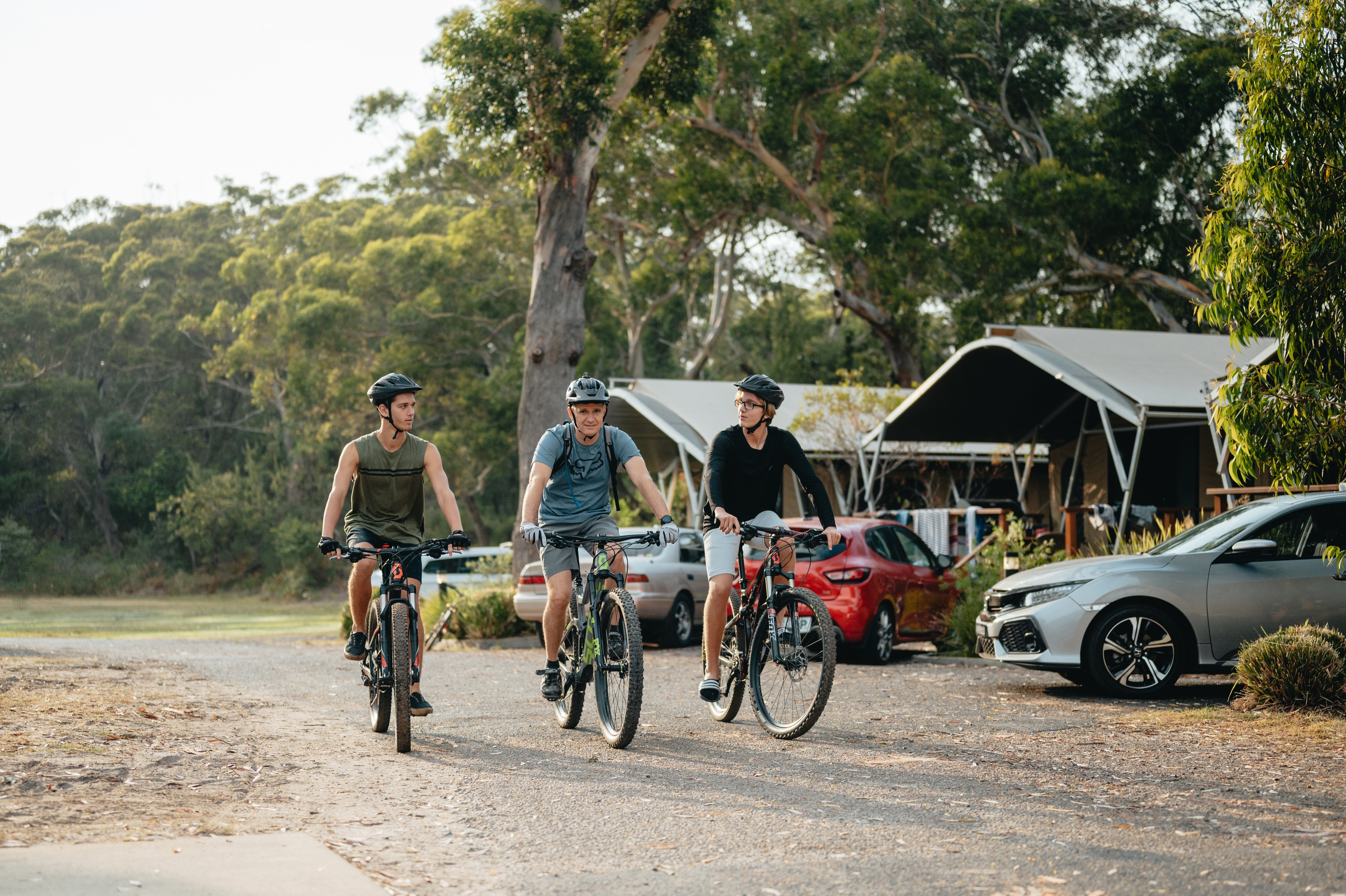 Image of a family bike riding at Reflections Holiday Parks Jimmys Beach