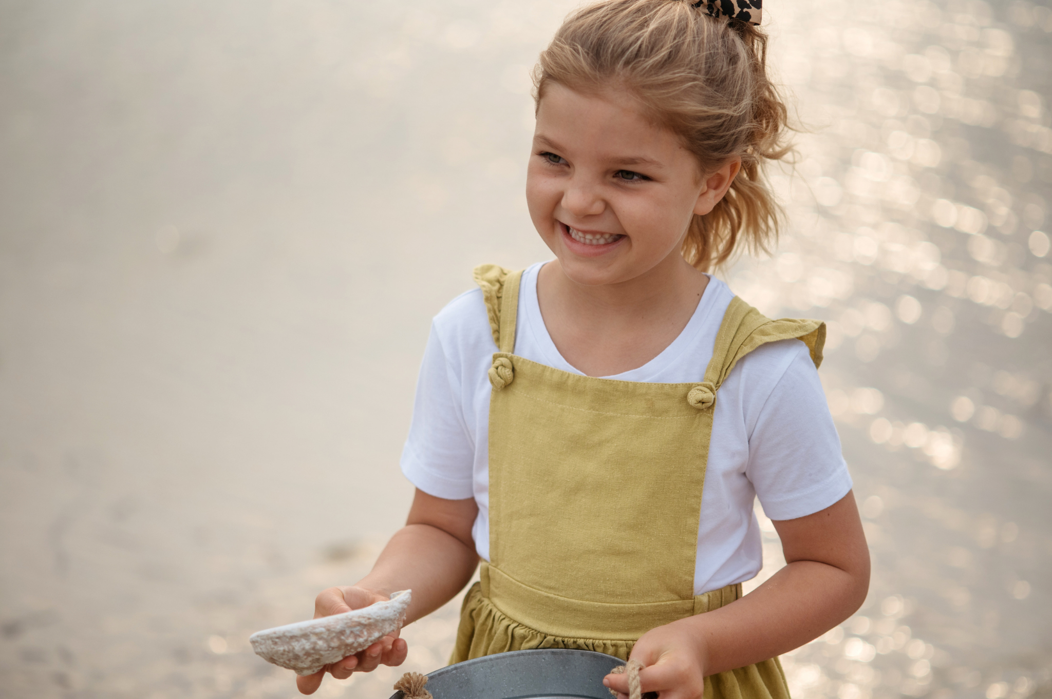 Image of a girl holding a shell at Reflections Holiday Parks Jimmys Beach