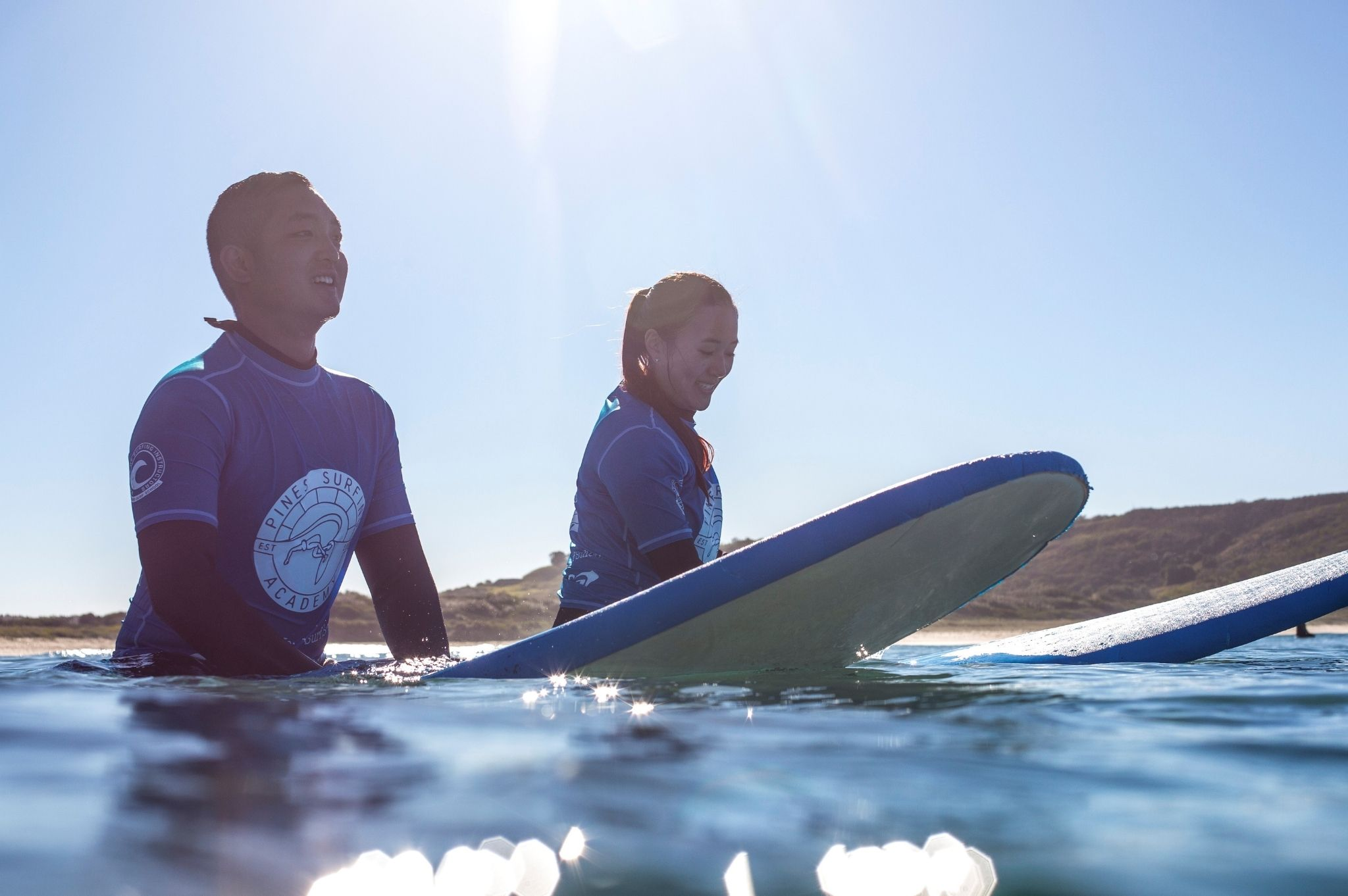 Image of a couple surfing at Reflections Killalea Reserve